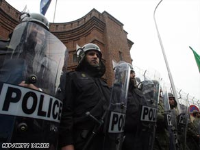Iranian police guard French embassy in Tehran on January 25 during protest against EU decision.