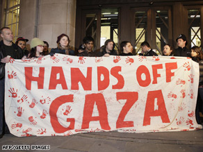 Protesters hold a banner outside the entrance of BBC Broadcasting House in central London.
