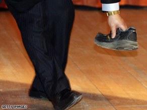 Protester throws shoe at China's premier