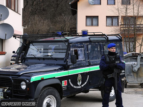 Portuguese peacekeepers stand guard outside a home raided on Tuesday.