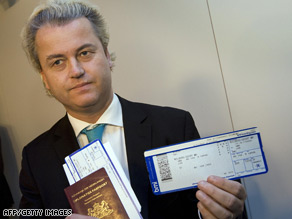 Geert Wilders shows his passport and boarding pass at Amsterdam's Schiphol airport before leaving for London.