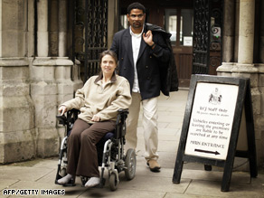 Debbie Purdy and husband Omar Puente pictured outside the High Court in October 2008.