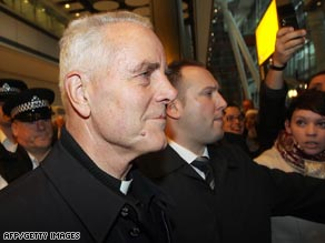 Bishop Williamson arrived in England surrounded by police and reporters.