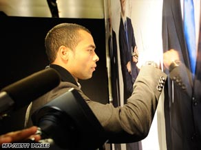 Ashley Cole, pictured signing an autograph at a charity event in London Wednesday.