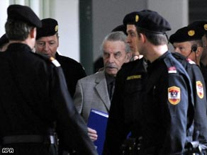 Josef Fritzl conceals his face as he arrives in court in St. Poelten Tuesday.