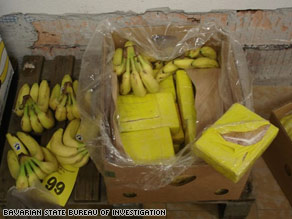 Government-released photos show bananas and packages of what is identified as cocaine.