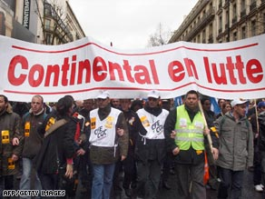 French workers have taken to the streets to protest job losses and the bonuses paid to executives.