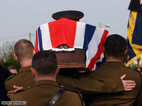 Comrades carry the coffin of sapper Mark Quinsey in Birmingham, England, on March 18.