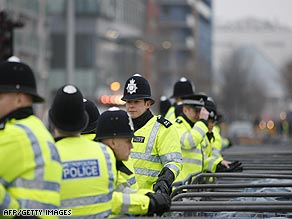 Police officers stand near barriers outside the ExCel Center in London's docklands.