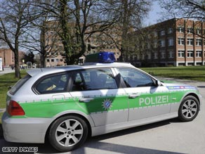 A police car sits outside the courthouse in the German city of Landshut.
