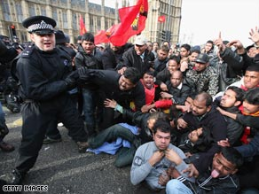 Police clash with Tamil protesters outside the Houses of Parliament.
