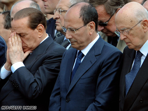 Berlusconi (left) alongside Senate leader Renato Schifani and Italian President Giorgio Napolitano at Friday's funeral.