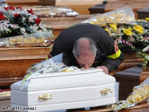 Mourners gather Friday for the funeral service for victims of the quake that shook central Italy Monday