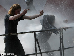 Police use water cannons to disperse protesters at a demonstration in Ulm, southern Germany.