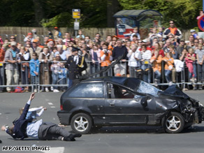 A car is pictured after crashing into the crowd waiting for the visit of the royal family in Apeldoorn.