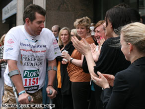 British Maj. Phil Packer is honored by a military band May 7 as he attempts to complete the London Marathon.