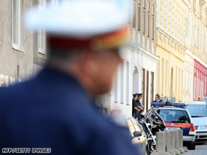 Austrian police secure the area outside a Sikh temple in Vienna where a shooting occured Sunday.