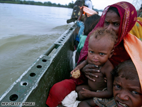 Victims of flooding in India last year are ferried to safety by the Indian Army in the northeastern state of Bihar.