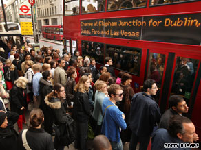 Commuters queue for packed buses in London on Wednesday morning.