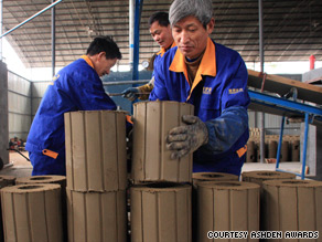Workers at Shengzhou Stove Manufacturers prepare wood-burning stoves for firing.
