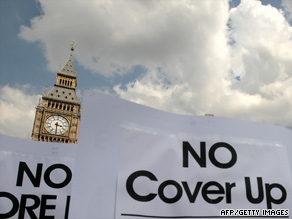 "Protesters hold placards with ""No Cover Up"" and ""No More Lies"" in London on Monday."