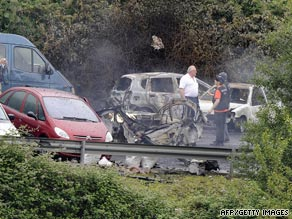 Police investigate the vehicle destroyed by a car bomb in Spain's Basque region.