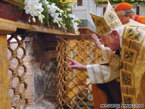 Pope Benedict XVI looks at the tomb of St. Paul at the Basilica of St. Paul in Rome in 2007.