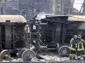 Flames engulf cars near Viareggio railway station in western Italy on Monday.