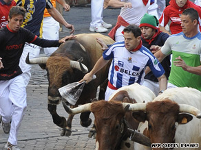 Runners take part in the running of the bulls in Pamplona, Spain on July 9.