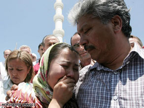 A Uyghur student cries as Turks pray on Friday in Ankara, Turkey, for people who died in protests in Urumqi, China.