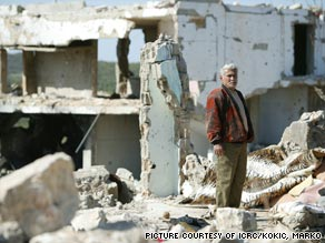Lebanon, 2007. A man returns to his ruined home in Aita Esh-Shaab village, close to the Israeli border