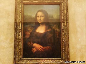 "The ""Mona Lisa"" sits behind bulletproof glass in the Louvre gallery."