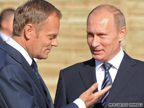Russian Prime Minister Vladimir Putin (right) chats with his Polish counterpart Donald Tusk in Poland on Tuesday.