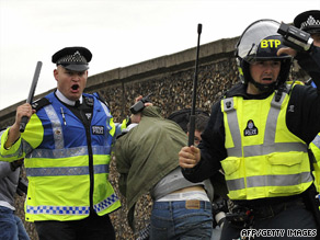 Police arrest a protestor in Harrow, London, after fighting broke out at a planned right-wing demonstration.