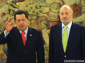Spanish King Juan Carlos, right, welcomes Venezuelan President Hugo Chavez to Madrid on Friday.