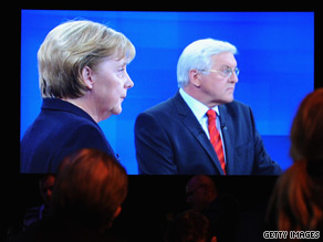 Chancellor Angela Merkel and rival Frank Walter Steinmeier are shown on a giant screen.