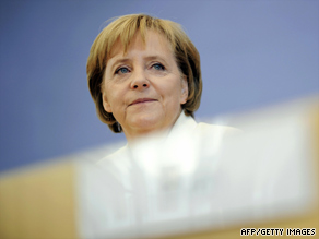 German Chancellor Angela Merkel addresses a press conference in Berlin on Friday.