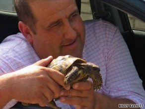 John Formby holds Freeway the tortoise Saturday, September 19 in Worthing, England.