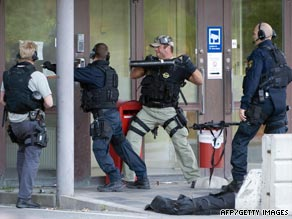 A police Swat team enter a G4S cash depot in Vastberga, Stockholm.