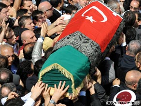 Relatives carry the coffin of Osman on Saturday after his funeral ceremony in Istanbul.
