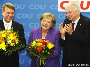 Angela Merkel and CDU party officials pose for photos at the party's headquarters in Berlin on Monday.