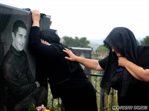 South Ossetian mourners at the grave of a relative killed in the conflict on the first anniversary in August 2009.