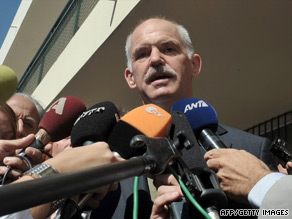 Supporters of Papandreou's party celebrate Sunday in Athens, Greece, after hearing news of the exit polls.