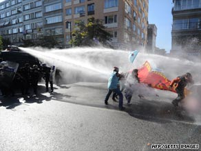 Riot police repel protesters in Turkey with water as they demonstrate near the IMF/World Bank meeting, October 7.