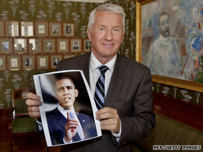 Chairman of the Nobel Peace Prize committee Thorbjorn Jagland holds a picture of President Obama.