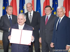 Polish President Lech Kaczynski holds the EU's Lisbon Treaty in Warsaw on October 10.