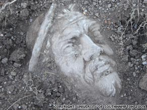 The statue head as it appeared beneath the soil during excavations at the site in Fumicino in early 2009.