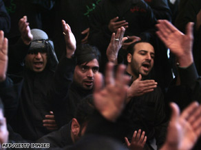 Shiites observe Ashura Saturday in Karbala, where the pilgrims whose bus was bombed were headed.
