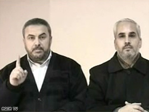 Hamas spokesmen Ismail Radwan, left, and Fawzi Barhoum appeared Saturday on television station Al-Aqsa.