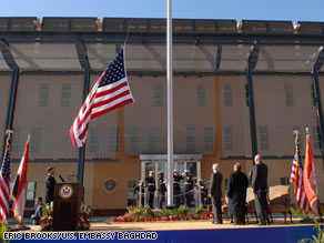 The American flag is raised at Monday's dedication ceremony for the new U.S. Embassy in Baghdad.